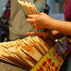 A Taiwanese vendor arranges hot cakes that are sold to the crowds passing by.