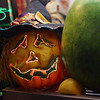An illuminated pumpkin is on display at food stall.