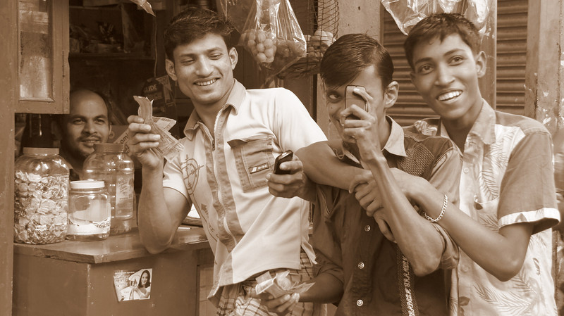 This is one of my favourite photos.  I'm taking of photo of this group of men and they take a photo of me with their cell phone - Old Dhaka, Bangladesh.