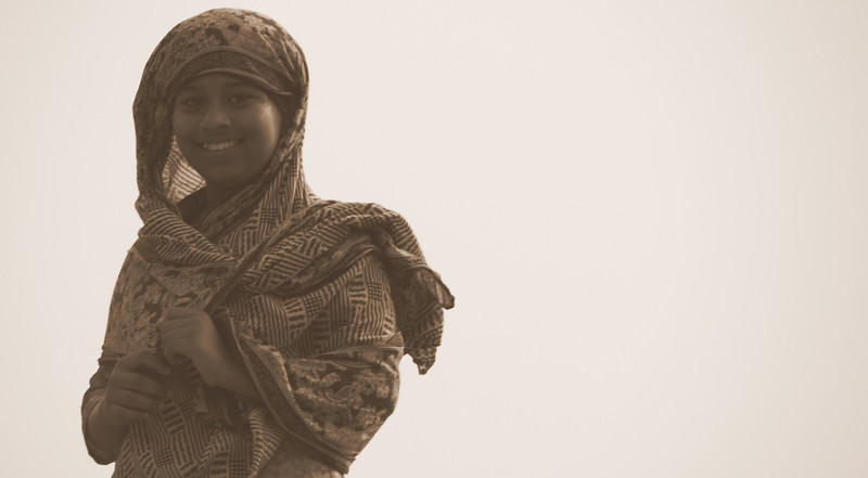 This girl was standing on top of a roof when she looked over and smiled at me - Old Dhaka, Bangladesh.