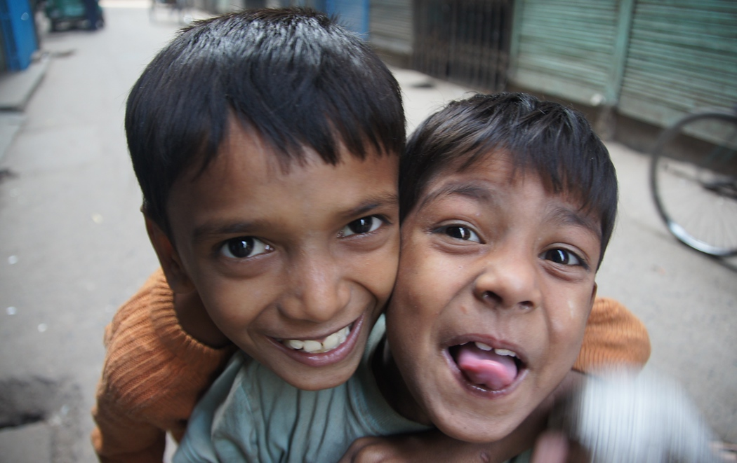 These two cute boys move in close to the camera as I capture their authentic smiles.- Old Dhaka, Bangladesh.