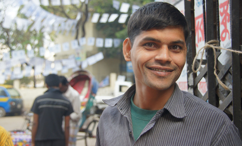 A local Bangladeshi man takes the time to stop and pose for the camera - Old Dhaka, Bangladesh.