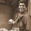 This man flashes an authentic smiles as he takes the time to show me a battered ball he was deep frying - Old Dhaka, Bangladesh.