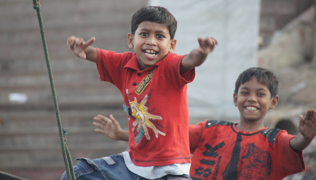 These two boys got up and started dancing on the small row boat they were riding along the Buriganga River - Old Dhaka, Bangladesh.
