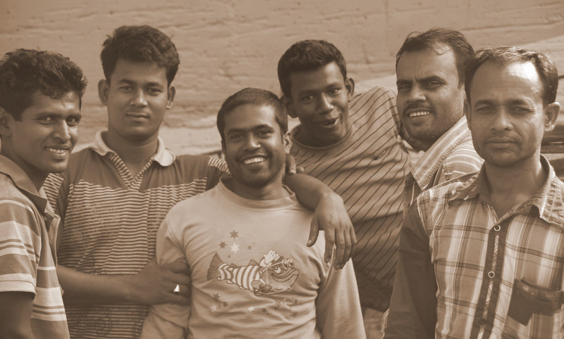 These group of men showcase their happy faces nearby a small factory in Old Dhaka, Bangladesh.