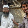 These two men smile as they pose for the camera in a back alley along Old Dhaka, Bangladesh.