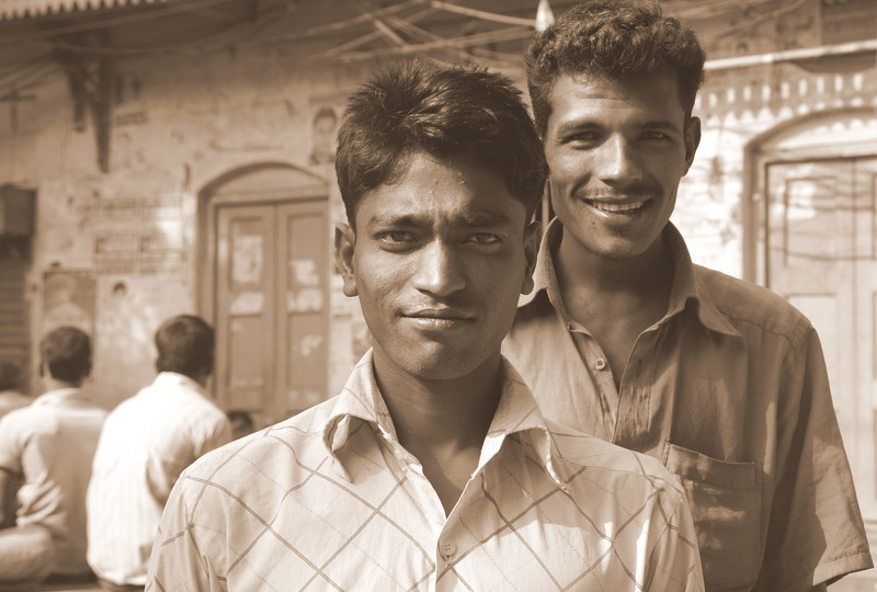 This edited sepia photo is of two men posing for the camera in Old Dhaka, Bangladesh.