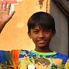 """A cute Bangladeshi boy waves hello to me:<br /> <a href=""""http://nomadicsamuel.com/photo-essays/authentic-smiles-from-bangladesh"""">http://nomadicsamuel.com/photo-essays/authentic-smiles-from-bangladesh</a>"""