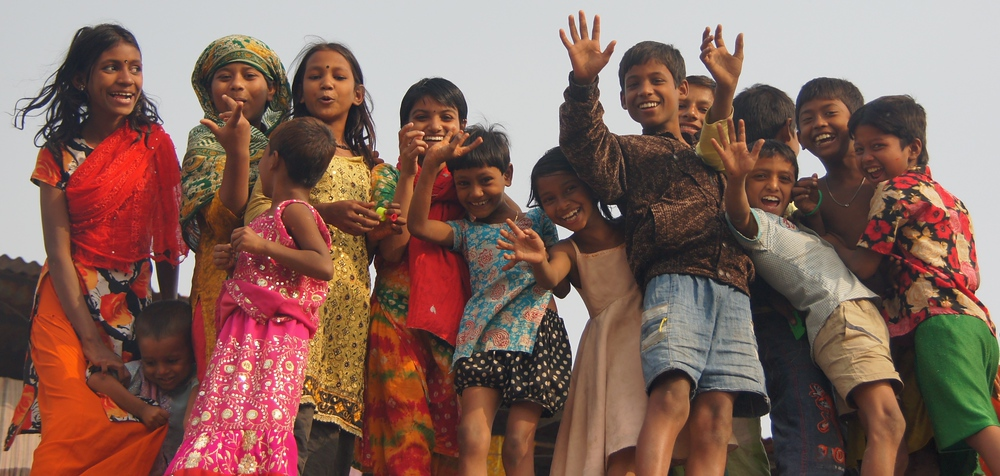 An ecstatic group of children wave to me from on top of a building nearby the Sadarghat in Old Dhaka, Bangladesh.