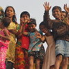 """An ecstatic group of children wave to me from on top of a building nearby the Sadarghat in Old Dhaka, Bangladesh:  <a href=""""http://nomadicsamuel.com/photo-essays/authentic-smiles-from-bangladesh"""">http://nomadicsamuel.com/photo-essays/authentic-smiles-from-bangladesh</a>"""