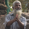 """This jolly looking Bangladeshi man with a distinctly long white beard clasps his hands together and smiles:<br /> <a href=""""http://nomadicsamuel.com/photo-essays/authentic-smiles-from-bangladesh"""">http://nomadicsamuel.com/photo-essays/authentic-smiles-from-bangladesh</a>"""