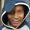 """This Bangladeshi boy wearing a hoody flashes a distinct smile:  <a href=""""http://nomadicsamuel.com/photo-essays/authentic-smiles-from-bangladesh"""">http://nomadicsamuel.com/photo-essays/authentic-smiles-from-bangladesh</a>"""