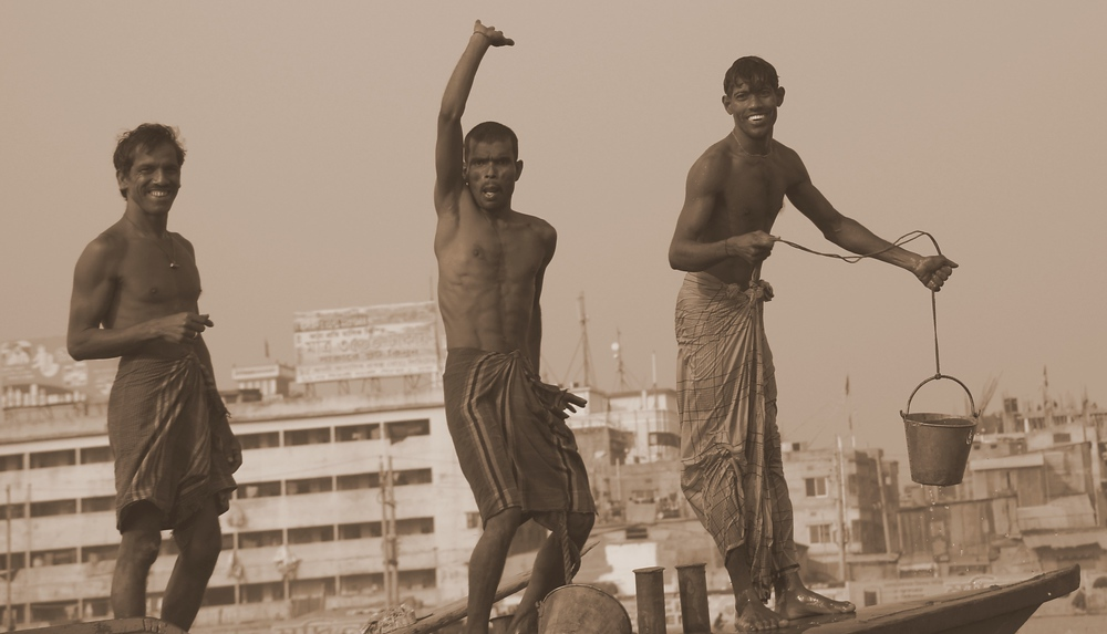 These three stooges were dancing, waving and smiling on board a larger vessel that we passed on the Buriganga River.