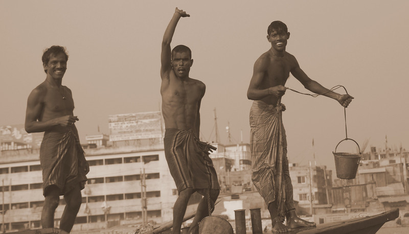 "These three stooges were dancing, waving and smiling on board a larger vessel that we passed on the Buriganga River:  <a href=""http://nomadicsamuel.com/photo-essays/authentic-smiles-from-bangladesh"">http://nomadicsamuel.com/photo-essays/authentic-smiles-from-bangladesh</a>"