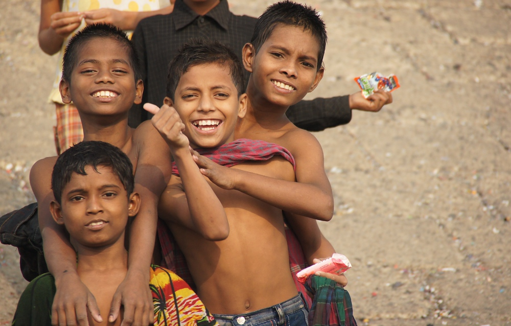 These boys huddled together and posed for a photo as I boarded a rowboat to explore the Buriganga River.