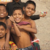 "These boys huddled together and posed for a photo as I boarded a rowboat to explore the Buriganga River:  <a href=""http://nomadicsamuel.com/photo-essays/authentic-smiles-from-bangladesh"">http://nomadicsamuel.com/photo-essays/authentic-smiles-from-bangladesh</a>"
