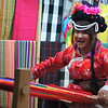 This lovely young Chinese lady weaves in downtown Lijiang, China while greeting me with a smile.