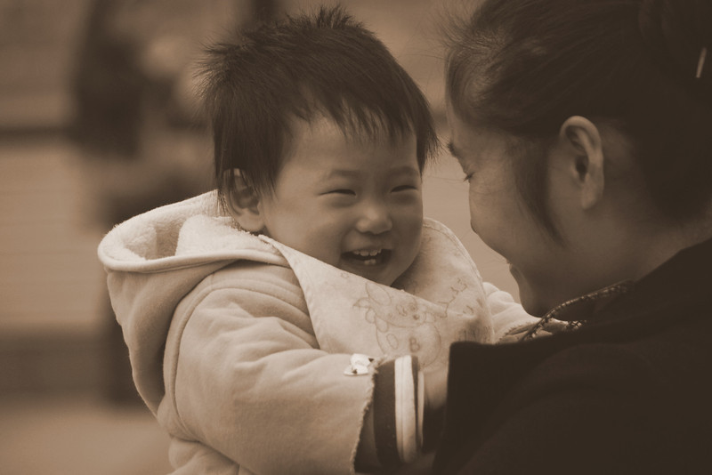 An adorably cute moment shared by child and mother nearby the Bund in Shanghai, China.