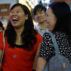 A group of Chinese ladies share an ear to ear smile/laugh with gums showing in hectic Causeway Bay, Hong Kong Island, China.