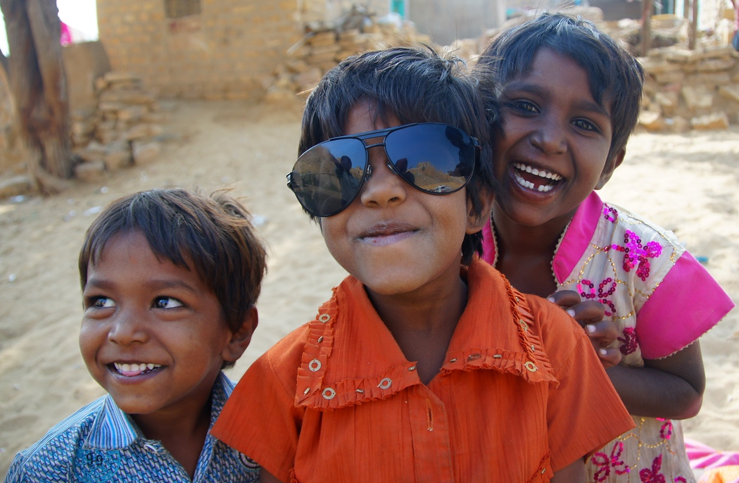 This group of cute children loved trying on my prescription sun glasses and sharing a laugh as I took their photo.  It was a fun moment I'll never forget.  The interesting thing about sunglasses is that I lost them a few weeks later while taking a train ride.  A gust of wind blew them off the side of the window all of a sudden.