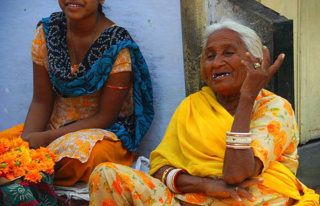 An elderly lady flashes an authentic smile on the streets of Udaipur - Rajasthan, India.