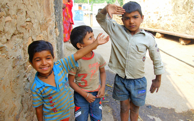 Yes sir!  These cute kids had fun striking poses for me while I took shots of them before and after distributing a few candies.  Travel photo from Udaipur - Rajasthan, India.