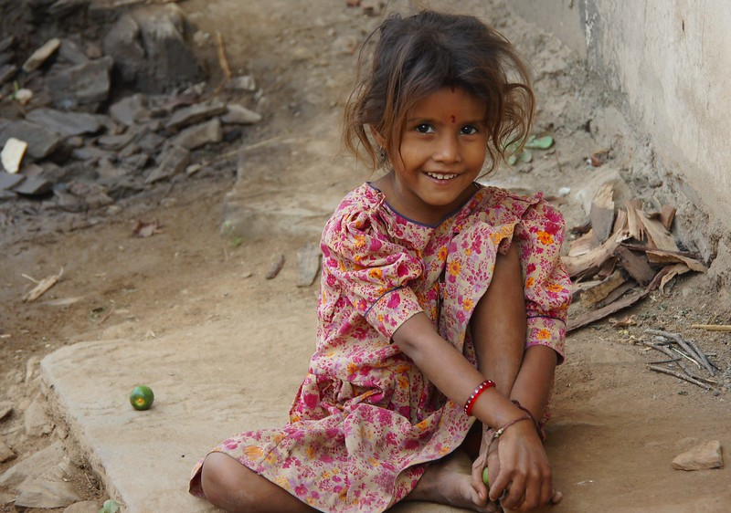 I'll never forget this little girl.  I met her on a horseback riding tour just outside of Udaipur.  People who are so warm and genuine living humble conditions inspire me.  Travel photo from Rajasthan, India.