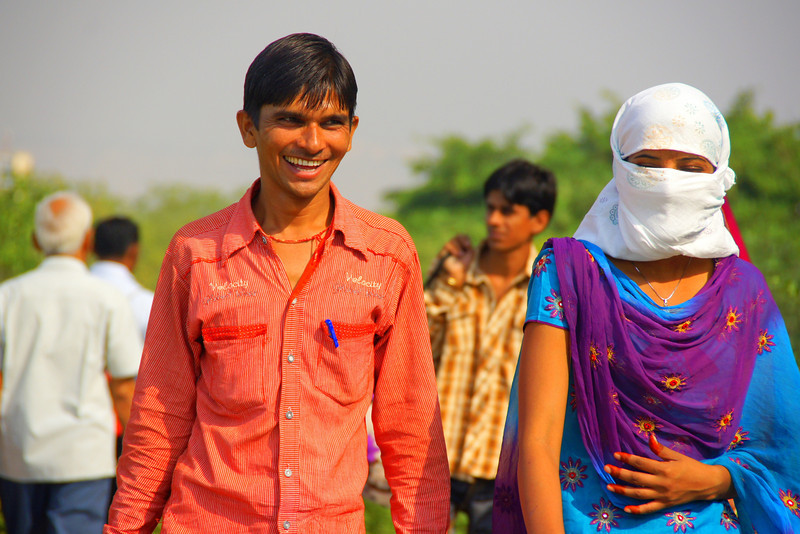 A man beams a great big grin as he strolls along a park area located in Jaipur - Rajasthan, India.