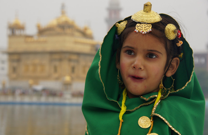 This is one of my favourite photos from India.  I just feel the expression on her face is quite priceless.  This photo was taken at the Golden Temple (Harmandir Sahib) located in Amritsar, India.