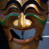 A Korean traditional mask (that looks rather happy) on display and for sale at a local shop located in Insadong - Seoul, South Korea.