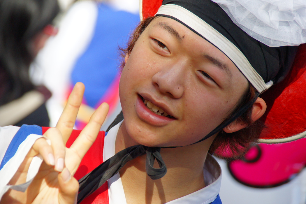 A young teenage male performer posing for a shot after just completed some impressive Korean Folk dancing at the Korean Folk Village - Yongin, South Korea.