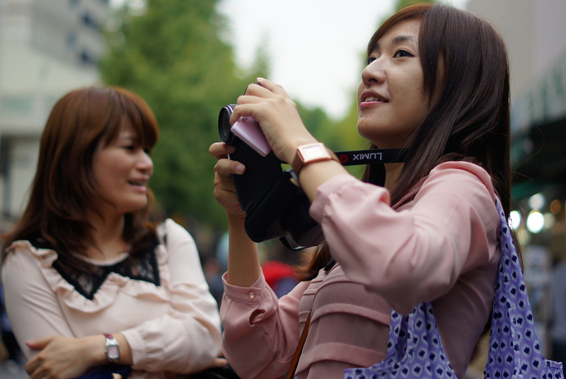 A photo of either a tourist or local taking shots of a store along Insadong - Seoul, South Korea.