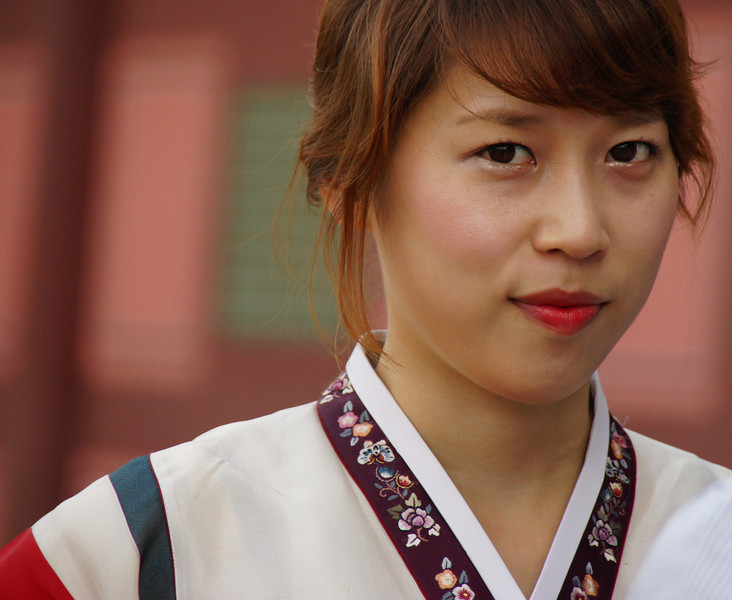 A picture of a Korean lady wearing traditional clothing (also known as Hanbok) at Gyeongbokgung Palace located in Seoul, South Korea.