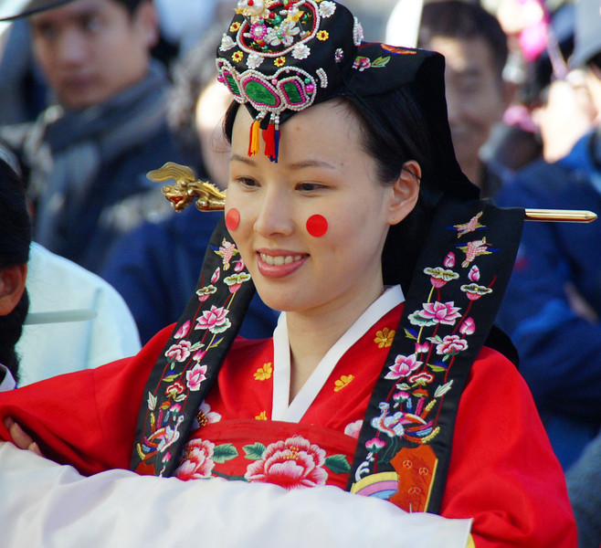 A smile of the Korean bride during a tradition wedding ceremony (which was staged) at the Korean Folk Village - Yongin, South Korea.