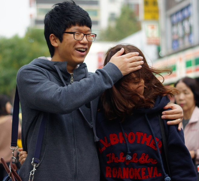A candid moment shared between a couple of the bustling street of Insadong - Seoul, South Korea.