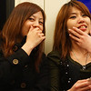 These two ladies share a candid conversation and giggle on the metro in Taipei, Taiwan.