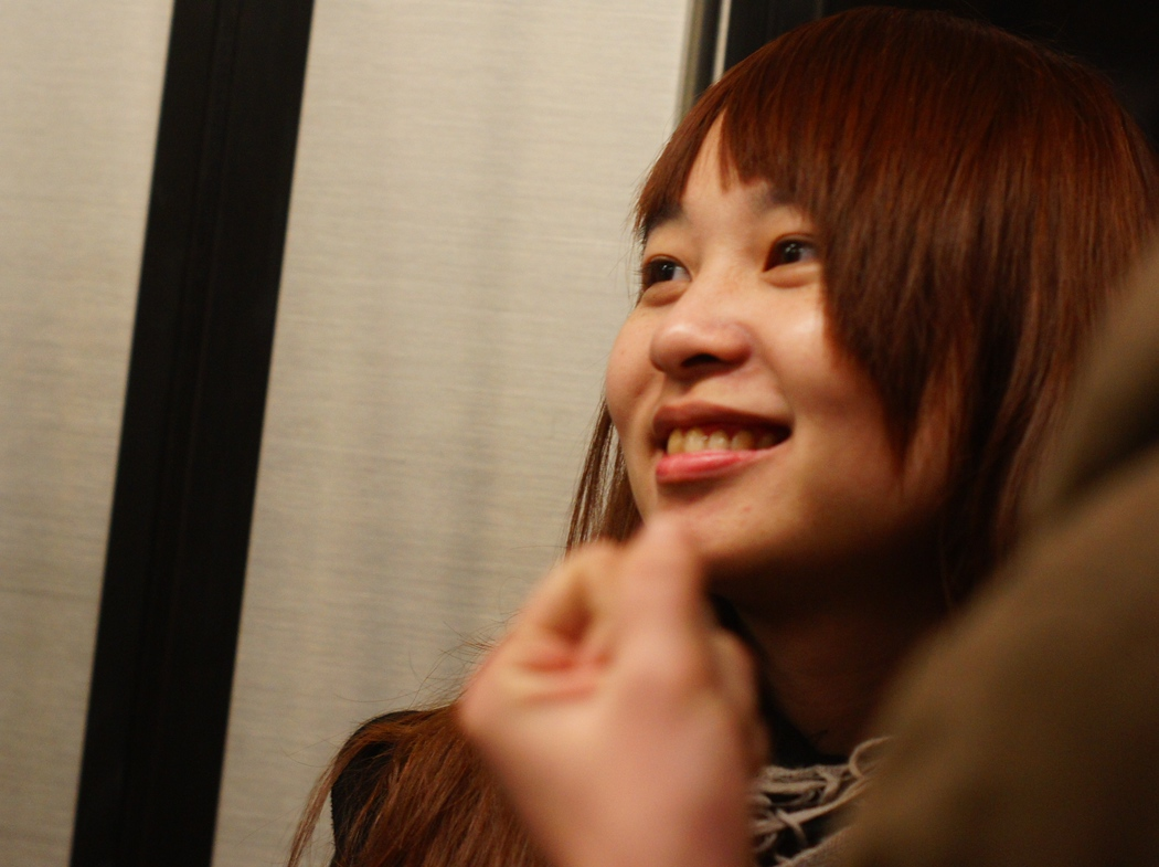A lady smiles in Taipei, Taiwan.