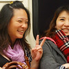 Two ladies share a laugh together while one of them makes a peace symbol - Taipei, Taiwan.