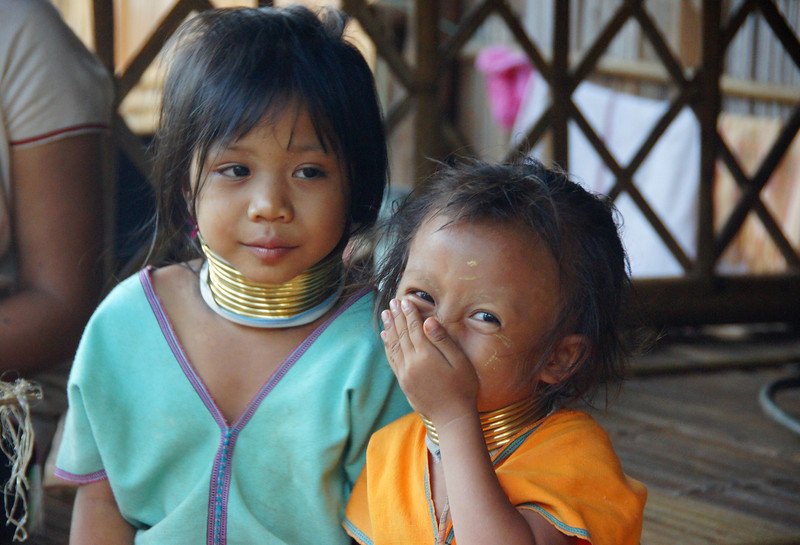 This is a travel photo from Thailand - candid portraits of Thai people smiling.
