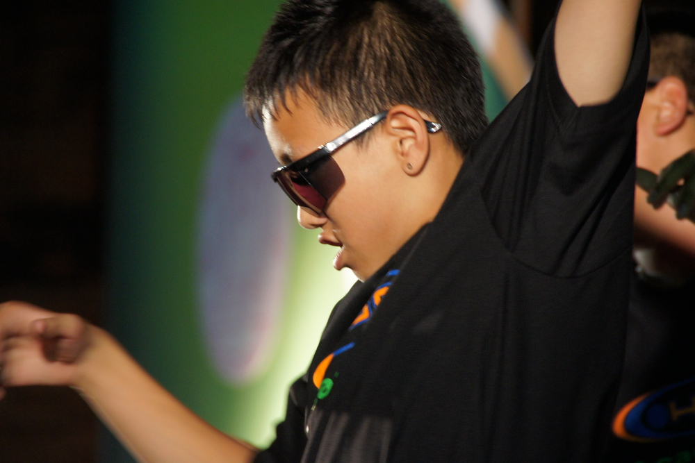 A close-up shot of one of the Thai teenage boys performing a hip hop sequence.