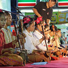 A group of Thai teenagers play traditional Thai instruments on the stage.