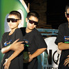 A group of teenage Thai boys decked out in matching black outfits perform a rap routine.