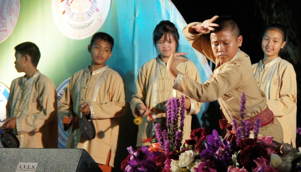 A photo capturing a Thai boy doing some impressive martial art display.