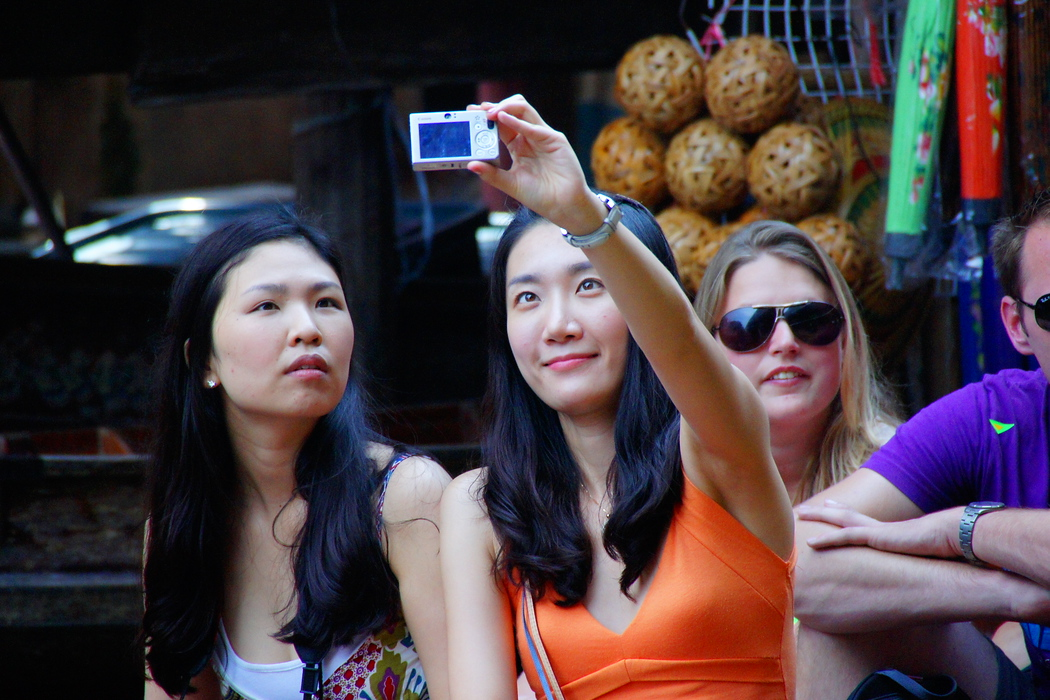 A selfie portrait from two tourists visiting the floating market.