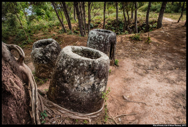 <b>There are bomb craters all across the Plain of Jars; the one above is  distinctive only because the trees have, for reasons of their own, staked  out its perimeter.