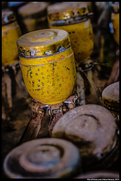 <b>Only the area within a few yards of the jars  has been cleared of unexploded bombs and  land mines. The jar-like objects above are  deactivated land mines from the Plain of Jars.