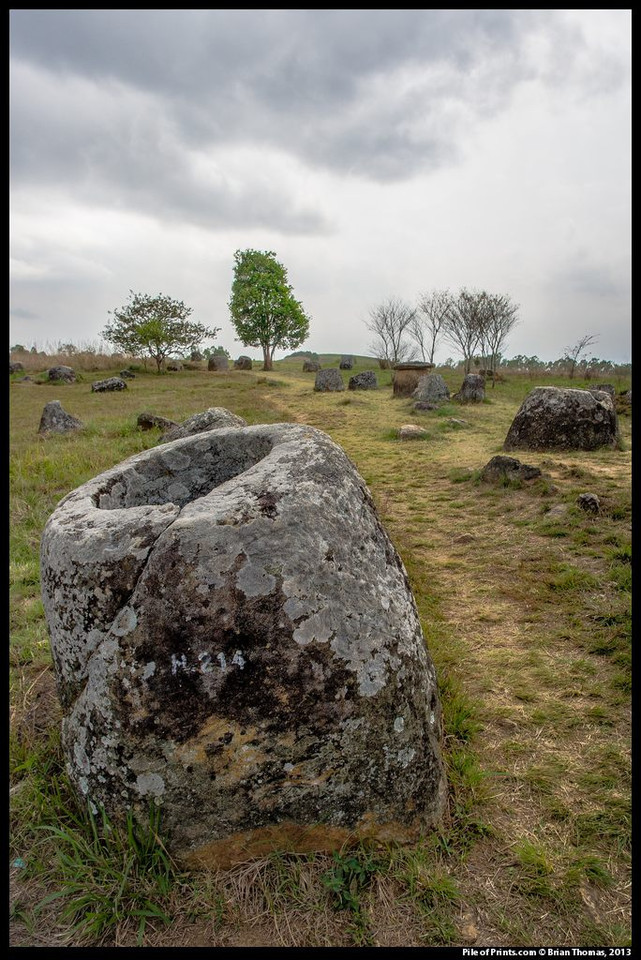 <b>In northeastern Laos a prehistoric people shaped boulders into stone jars that they arranged in clusters throughout the land. This region is called the Plain of Jars.