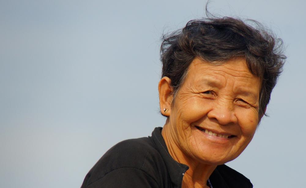 An elderly Vietnamese lady is as friendly as can be - Mekong Delta, Vietnam.