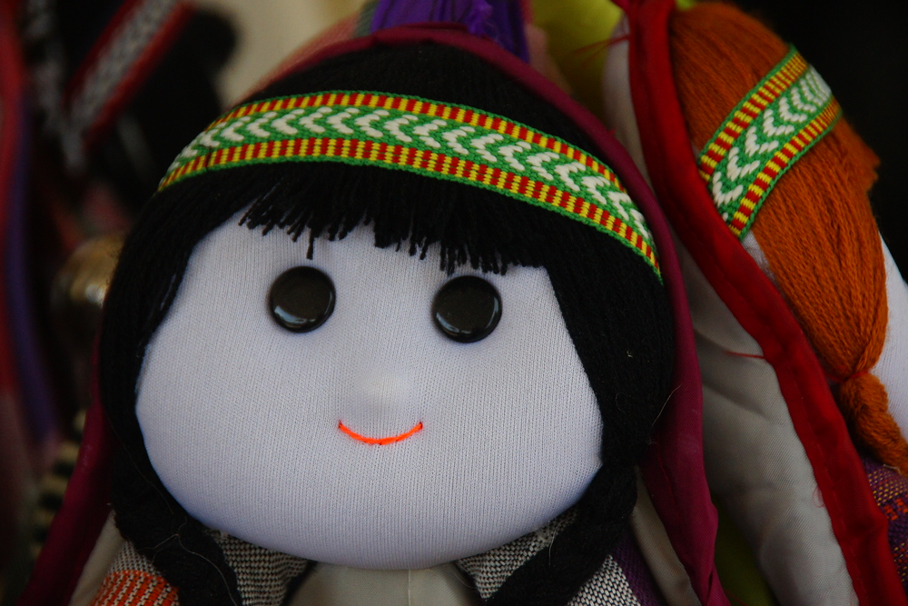 A smiling doll found in a handicraft section of a tourist market