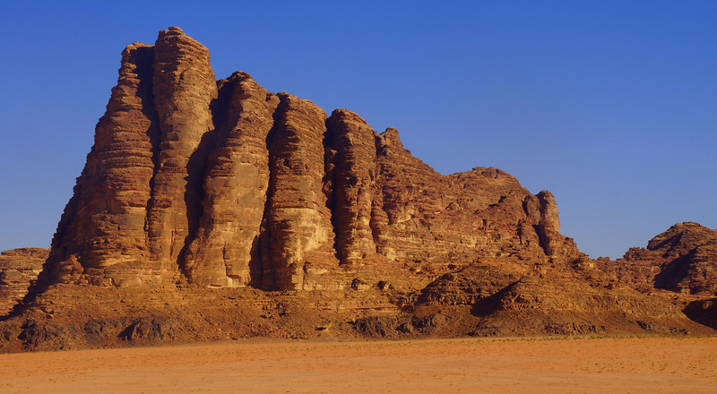 This is a shot of Seven Pillars of Wisdom Mountain in Wadi Rum, Jordan taken just after lunch.  Can you spot all seven?